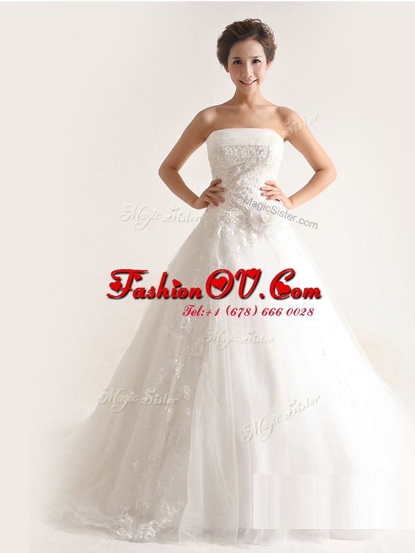 Captivating Strapless Sleeveless Tulle Wedding Gown Appliques Court Train Lace Up