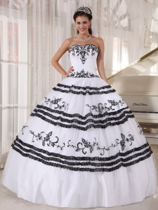 White Quinceanera Dress with Black Floral Embroidery and Hems