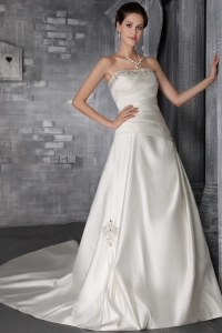 Popular Strapless Court Train Taffeta Beading Bridal Gown