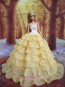 Ruffled Layers Decorate Ball Gown Light Yellow Barbie Doll Dress