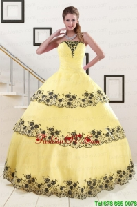 2015 Unique Light Yellow Quinceanera Dress with Appliques
