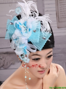 Feather and Rhinestones Decorate Aqua Blue Headpieces