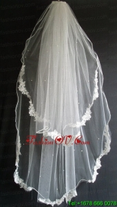 Lace Appliques And Beading Decorate Tulle Wedding Veil