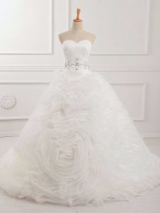 Sweetheart Sleeveless Wedding Gown Brush Train Beading and Ruching White Organza