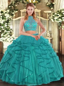 Sleeveless Tulle Floor Length Criss Cross 15th Birthday Dress in Turquoise with Beading and Ruffled Layers