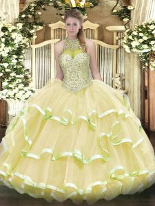 Light Yellow Ball Gowns Halter Top Sleeveless Organza and Tulle Floor Length Lace Up Beading and Ruffled Layers Sweet 16 Dresses