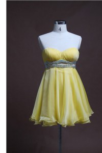 Luxurious Light Yellow Sleeveless Beading Mini Length Homecoming Dress