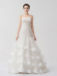 Strapless Sleeveless Tulle Wedding Gown Beading and Appliques and Ruffled Layers Brush Train Lace Up