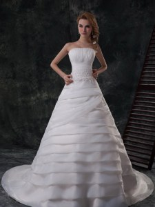 Strapless Sleeveless Bridal Gown With Brush Train Beading and Appliques and Ruffled Layers White Organza