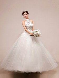 Inexpensive White Halter Top Neckline Beading and Appliques Wedding Gown Sleeveless Lace Up